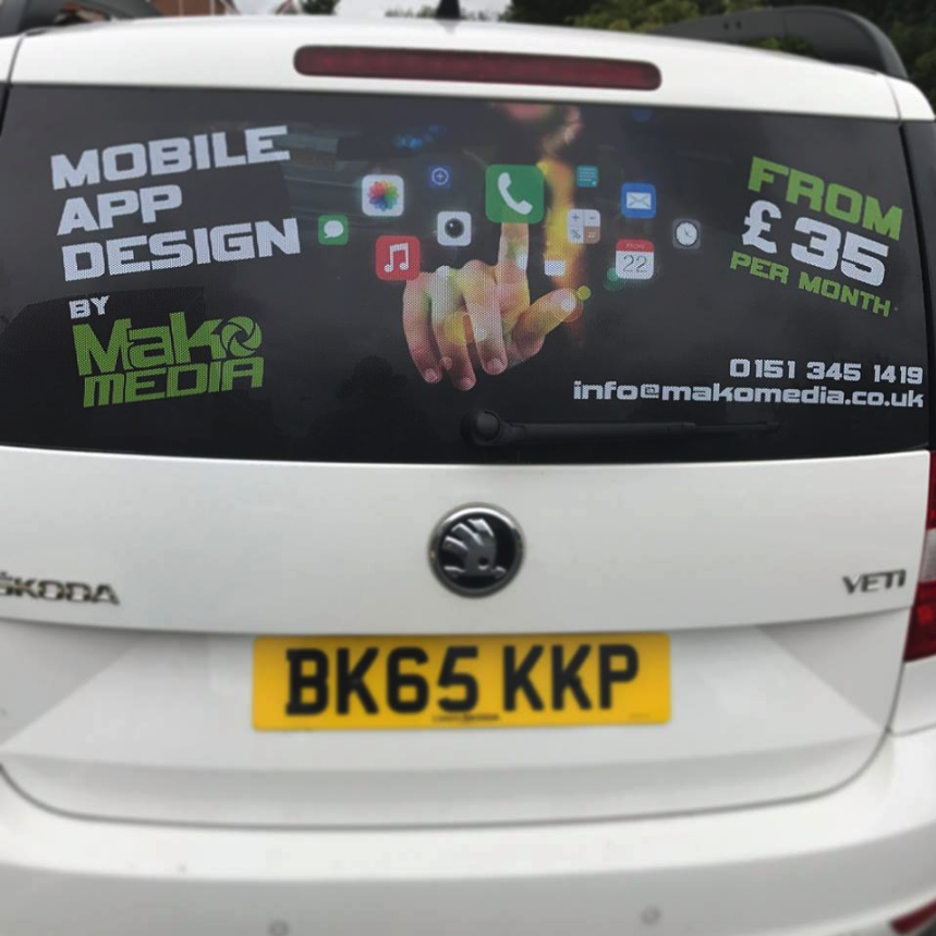 Close up Window View of MakoMedia's Mobile App Car Decals